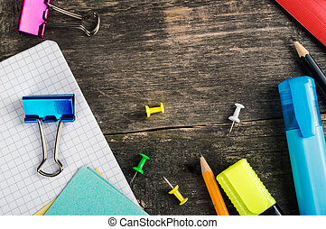 Frame of school supplies on wooden background. Top view