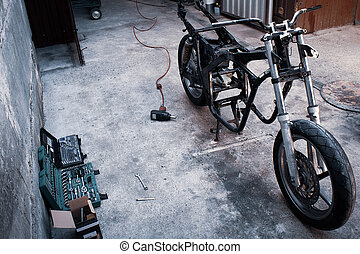 Frame of the motorcycle in the workshop tools kit