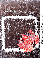 frame of the snow with a red leaf on a dark wooden background snowy winter brochure