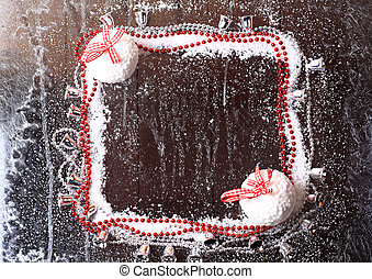 frame of the snow with Christmas balls on a snowy winter dark wooden background booklet