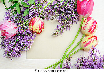 frame of tulips and lilac place for text
