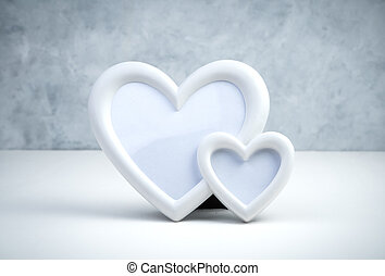 Frame of two hearts on a gray-white background.