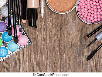 Frame of various makeup products with copy space