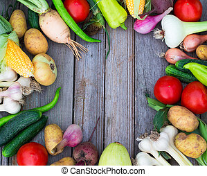 Healthy eating background of different fruit and vegetables on an old wooden table