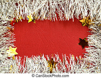 Frame of white tinsel on red background