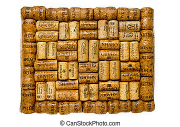 frame of wine corks on a white background