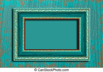 Frame on a vintage blue wall.