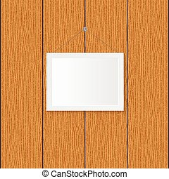 Frame on a wood background