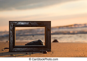 Frame on the beach at sunset