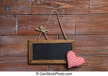 Frame on the brown wooden background