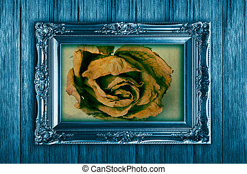 Frame on vintage wooden wall blue.