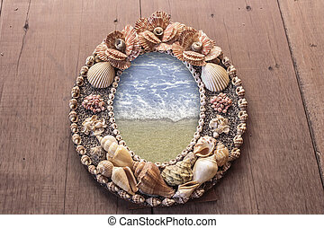 Frame picture made from shells. seas in the frame.