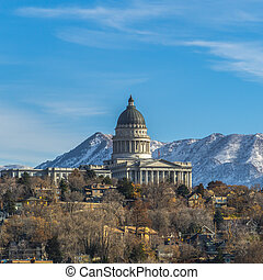 Frame Square The majestic Utah State Capital Building towering over houses in Salt Lake City