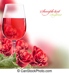 wine and roses - frame with a glass of wine and roses for...