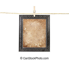 Frame with aged paper on a line