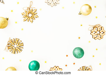 Frame with Christmas balls, wooden snowflake decorations on white background. Flat lay, top view
