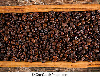Frame with coffee beans and cinnamon