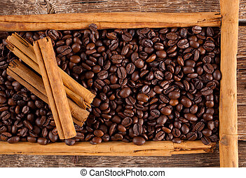 Frame with coffee beans andcinnamon