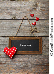 Frame with love heart on wooden background