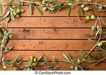 Frame with olive branches on table background top