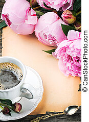 Frame with pink peonies and coffee