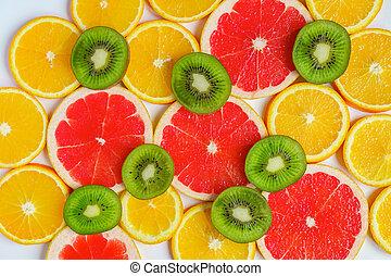 frame with slice of oranges, lemons, kiwi, grapefruit pattern isolated on white background. Flat lay, top view