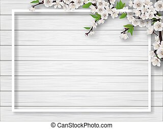Frame with spring blossoming cherry branches.