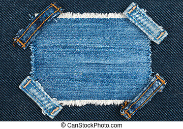 Frame with two straps jeans, lies on the blue denim
