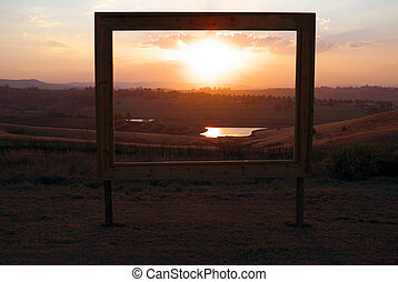 Framed African sunset in sales sign