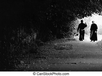 Framed - Black and white picture of two monks walking and ...