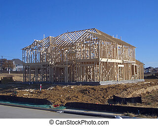 Framed House - A new house is being framed up in a suburban...