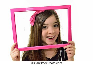 Framed - Young girl with her face framed in a pink picture...