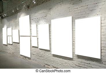 Frames on a brick wall