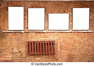 frames on red brick wall