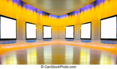 Blank picture frames in art gallery to be filled