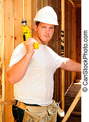 Framing Contractor Inside A New Home Holding A Power Drill
