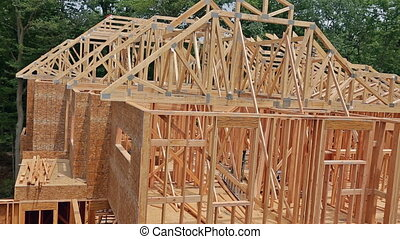 Framing of a new house under construction - New house under...