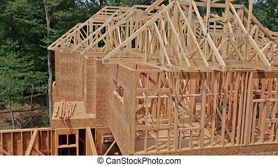 Framing structure wood frame of wooden houses home close-up...
