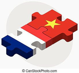 France and Vietnam Flags in puzzle isolated on white...