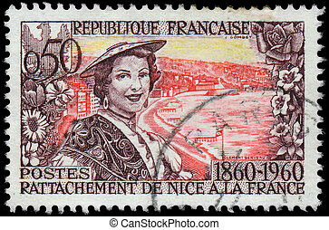 FRANCE - CIRCA 1960: a stamp printed in the France shows a women and Nice, circa 1960