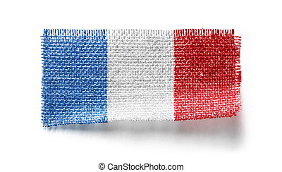 France flag on a piece of cloth on a white background