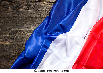 France Flag on a wooden Table