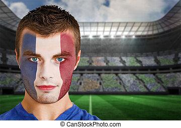 France football fan in face paint