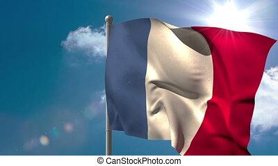 France national flag waving on flagpole on blue sky...