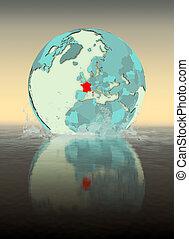 France on globe splashing in water