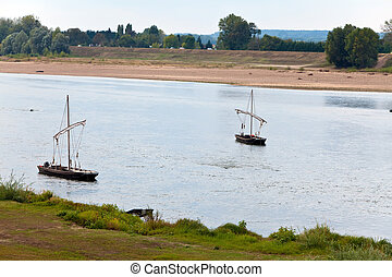 France. Two boats on the river Loire.