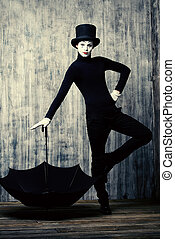 franch man - Elegant male mime artist in top hat posing with...