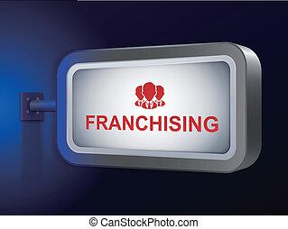 franchising word on billboard over blue background