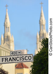 Francisco street sign against the bells towers of Saints Peter and Paul Church - San Francisco CA