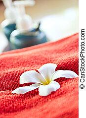 Frangipani on a red cloth.